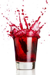 red liquid splash pomegranate juice